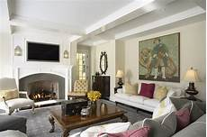 elegant and warm family room fireplace traditional living room minneapolis by erotas