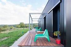 Artistic Cargo Shipping Container House Design Colorful Accents Artworks artistic shipping container house with colorful accents