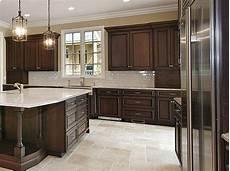 cherry cabinets with travertine tile floors kitchenremodelingideas kitchen backsplash