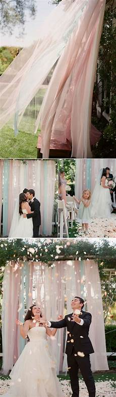 aqua pink wedding ceremony tulle fabric backdrop idea