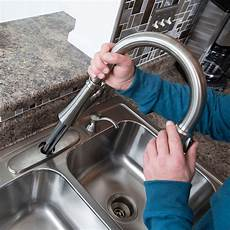 install a kitchen faucet faucet replacement resilient plumbing heating inc