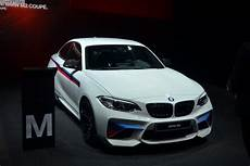 a beautiful bmw m2 alpine white with m performance parts arrives in geneva