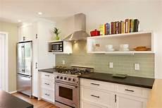 green subway tile backsplash kitchen mediterranean with