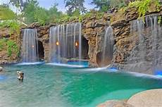 A Luxurious Pool With A Waterfall And A Cave At