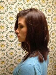 cut your own hair using 2 ponytails girly hair cuts diy haircut ponytail haircut