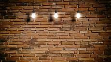 3d rendering light bulbs brick wall background stock
