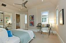 gorgeous electronic dart board in bedroom transitional with desk lighting next to light gray