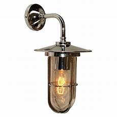 silver industrial style wall light with well glass shade
