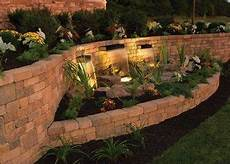 two level retaining wall love the lighting too sloped backyard garden landscaping garden