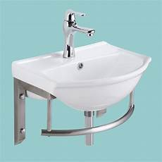 small wall bathroom sink with stainless steel towel bar