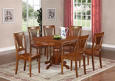 5 pc avon oval kitchen table with 4 plainville wood seat
