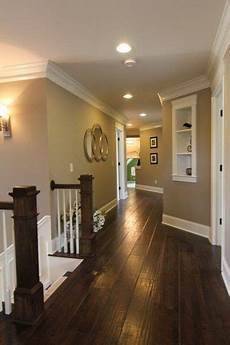 dark floors white trim warm walls i want to do this color combination but add the black doors