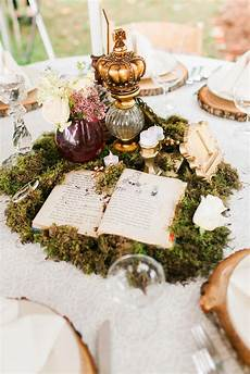 whimsical moss and vintage book centerpiece loie http knot ly 6493bivjv
