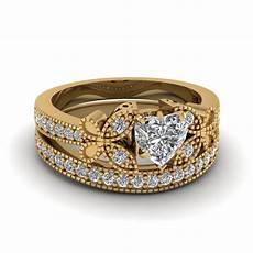 heart shaped vintage butterfly diamond wedding ring in 18k