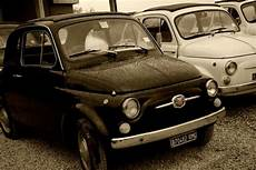 company activities italy on board of vintage fiat 500