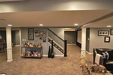luxury basement interior remodel with gray wall paint color and great style pillar design