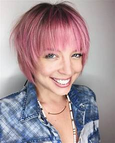 pink shaggy bob with feathered bangs and shadow roots