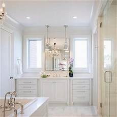 white master bathroom ideas all white master bathroom with chandelier tub