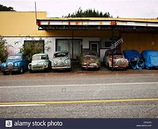Mobile Garage New Zealand by An Garage With Cars By The Roadside New