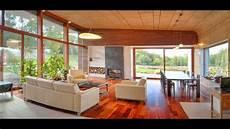 Haus Hanglage Modern - l shaped modern house design on hillside with