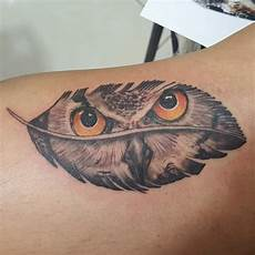 grey ink unique owl in feather tattoo design