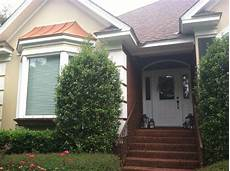 help what exterior paint color works with brick and a copper roof