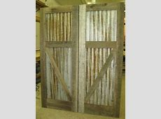 corrugated tin with wood frame doors. think for shed and