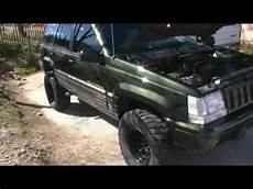 jeep zj lifted grand with flowmaster 33s 5 2