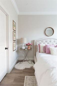 white and pink bedroom inspiration white walls white bedding pink accent pillows hardwo