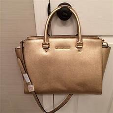 11 off michael kors handbags sold michael kors selma large gold from merry s closet