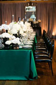 glamorous emerald black and white wedding table with lamour boxwood linens from napa valley