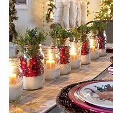 composizioni con candele candele lanterne bacche pigne o spezie fai da te il