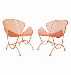 a pair of modern homes with distinctively bright color pair of bright orange salterini slice chairs c1960