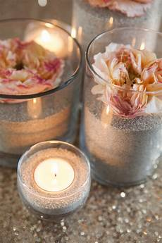come creare le candele make these gorgeous sand and flower centerpieces