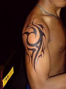 Oberarm Tribal - 23 tribal wave tattoos