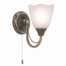 haughton single wall light in brass with an opal glass shades switched endon 601 1an