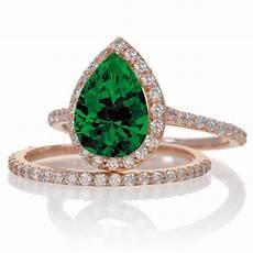 2 carat emerald and diamond halo bridal ring 10k