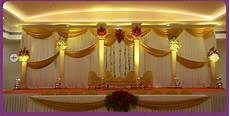 a wedding planner indian wedding and reception stage decorations