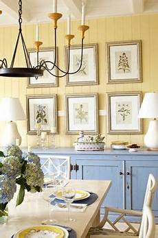 turquoise mudroom features mustard yellow paint upper walls and turquoise beadboard lower