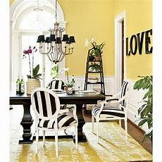 the black and white used with this yellow dining room is very similar to our color scheme