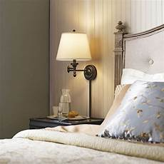 conserve valuable bedside table space by installing a chic and convenient swing arm wall l