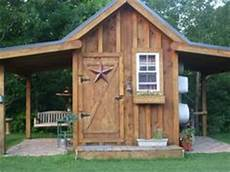 14 x16 custom garden shed with board batten siding mahogany stain 6 lite windows