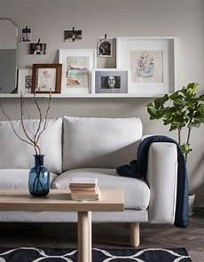 dessus de canapé ikea a picture ledge sits above a sofa and holds framed photos