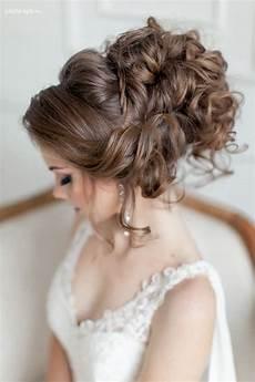 venician textured curls woven into a high bun wedding hairstyles for hair