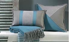 coussin prestige avec nuances de bleu turquoise et de gris