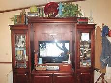Decorating Ideas Top Of Entertainment Center by On Willie Mae Thrifty Living Room Decor