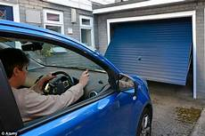 car in driveway no insurance half britain s garages now just used to store clutter