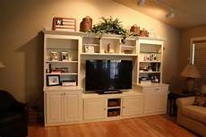 Decorating Ideas Top Of Entertainment Center by Decorating Tops Of Entertainment Centers How