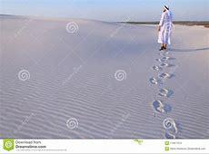 Joyful Male Muslim Walks Through White Sand Desert And