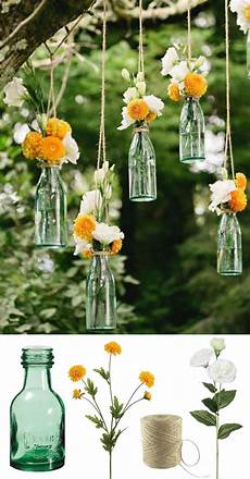 easy and low cost wedding decorations make this beautiful hanging bottle display with silk